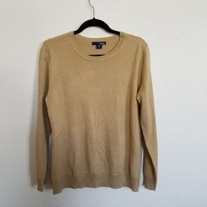 woman large gold sparkle sweater